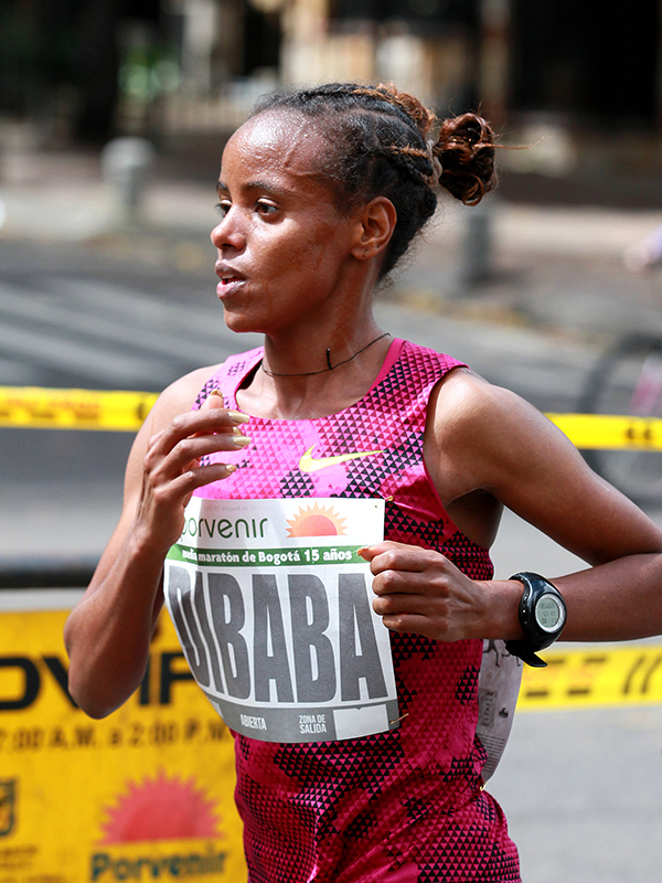 Mare Dibaba (ETH) will be aiming to run a very fast time in Berlin and challenge the Kenyan duo.